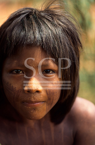 A-Ukre Village, Brazil. Pidjore, a Kayapo boy with intricate black genipapo face and body painting. Xingu .