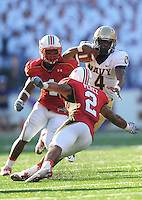 QB Ricky Dobbs of the Navy alludes Antwine Perez of the Terrapins. Maryland defeated Navy 17-14 at the M&T Bank in Baltimore, MD on Monday, September 6, 2010. Alan P. Santos/DC Sports Box