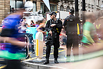 © Joel Goodman - 07973 332324 . 28/05/2017 . Manchester , UK . Armed police guard the starting stage of the run at the junction of Portland Street and Oxford Street in Manchester City Centre . The Great Manchester Run 2017 . Security is still heightened in Manchester following a murderous bomb attack at an Ariana Grande gig at Manchester Arena on Monday 22nd May . Photo credit : Joel Goodman