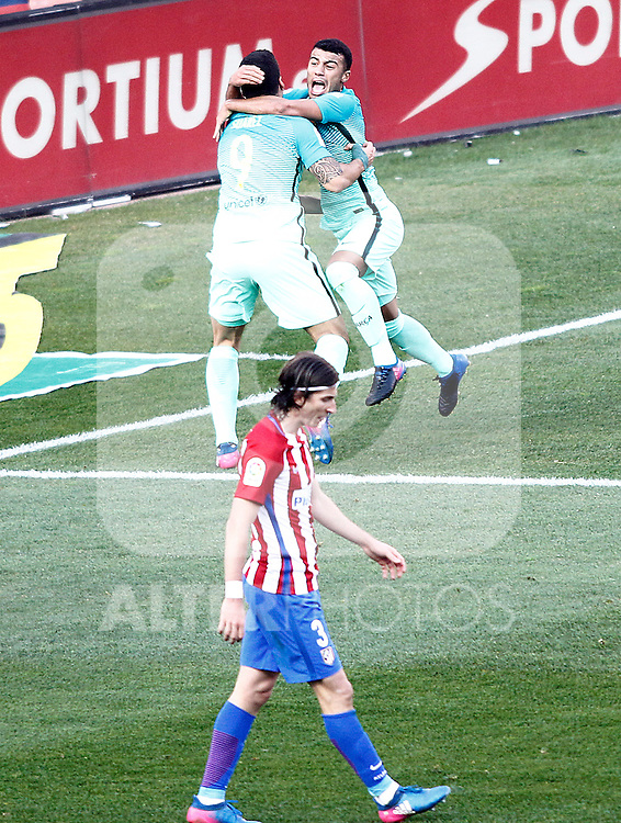 FC Barcelona's Rafinha Alcantara and Luis Suarez celebrate goal in presence of Atletico de Madrid's Filipe Luis dejected during La Liga match. February 26,2017. (ALTERPHOTOS/Acero)