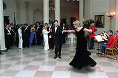 In this photo provided by the Ronald Reagan Presidential Library Princess Diana dances with John Travolta in the Cross Hall of the White House in Washington, D.C. at a Dinner for Prince Charles and Princess Diana of the United Kingdom on November 9, 1985.<br /> Mandatory Credit: Pete Souza - Courtesy Ronald Reagan Library via CNP
