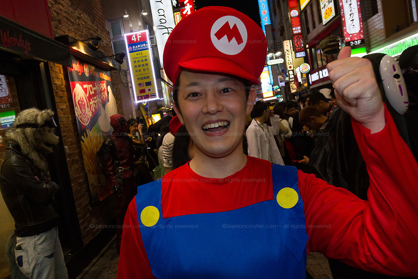 A Japanese man dressed as Mario from the Super Mario games during the Halloween celebrations Shibuya, Tokyo, Japan. Saturday October 27th 2018. The celebrations marking this event have grown in popularity in Japan recently. Enjoyed mostly by young adults who like to dress up, drink , dance and misbehave in parts of Tokyo like Shibuya and Roppongi. There has been a push back from Japanese society and the police to try to limit the bad behaviour.