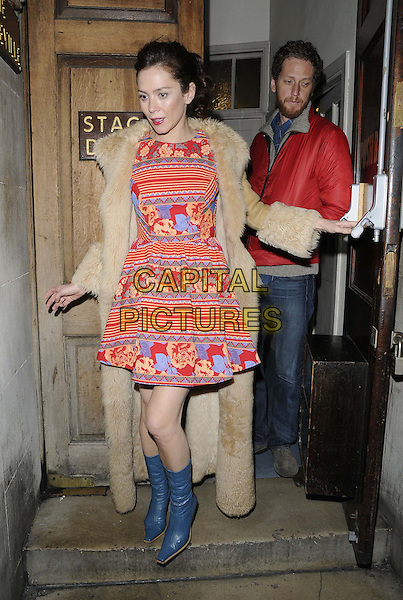 Anna Friel.departed after the evening performance of 'Uncle Vanya', Vaudeville Theatre, The Strand, London, England..December 18th, 2012.full length beige fur coat red white yellow blue striped stripes floral print dress boots door.CAP/CAN.©Can Nguyen/Capital Pictures.