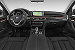 Stock photo of straight dashboard view of a 2015 BMW X6 sDrive35i 5 Door SUV Dashboard