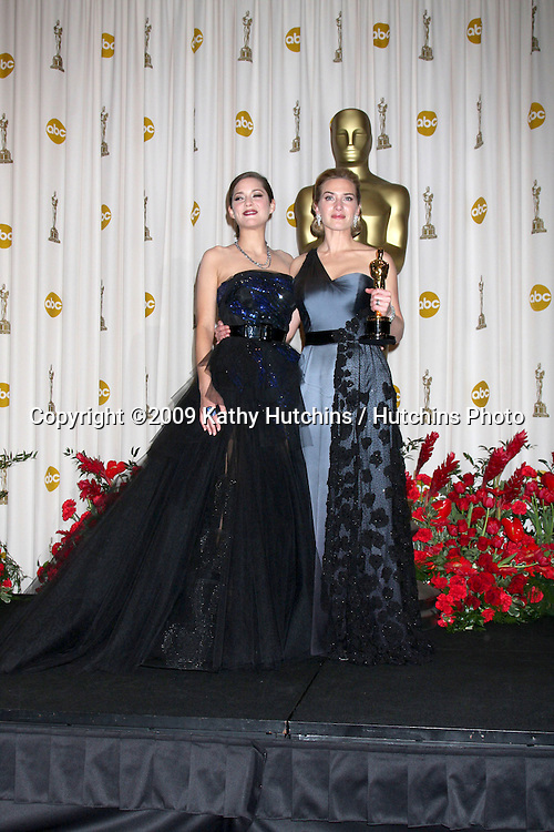 Marion Cotillard & Kate Winslet in the Press Room at the 81st Academy Awards at the Kodak Theater in Los Angeles, CA  on.February 22, 2009.©2009 Kathy Hutchins / Hutchins Photo...                .
