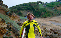 Shaun Brooks (AUS) walking along the rocks at Rincon on the way to a surf at his home break of Bells Beach. circa 1992.Photo:joliphotos.com