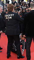 "CANNES, FRANCE. May 16, 2019: Taron Egerton ties Sir Elton John's shoelace at the gala premiere for ""Rocketman"" at the Festival de Cannes.<br /> Picture: Paul Smith / Featureflash"