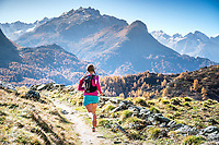 Trail running near Maloja, in the Engadin, while on a running tour to Piz Lunghin. Switzerland.