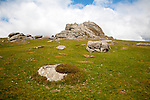 People scrambling on the granite tor of Haytor, Dartmoor national park, Devon, England