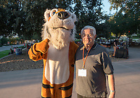 Ronald Oswald '57 and Oswald. Occidental College students, their families and alumni enjoy the Tiger Tailgate & Oswald's Carnival in the Academic Quad during Homecoming, Oct. 25, 2014. (Photo by Marc Campos, Occidental College Photographer)