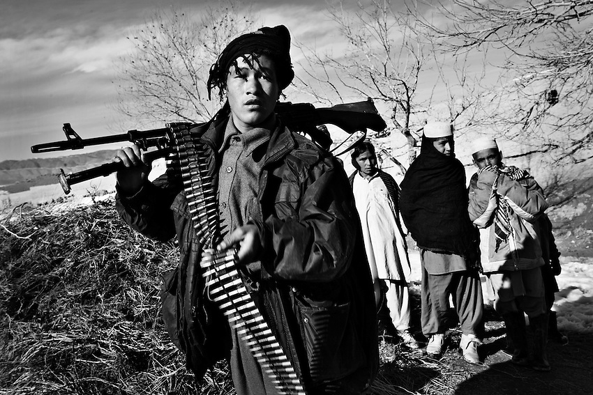 A young member of the Afghan National Police participates in an air assault in the village of Ebrahim, Paktika Province, Afghanistan, Jan. 23, 2009. In contrast to the better trained and better equiped Afghan National Army, the ANP in general is poorly trained and undisciplined.