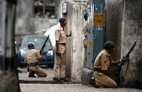 Policemen during the gunfight at Nariman House, home to the Hasidic Jewish group Chabad-Lubavitch, where hostages were being held after multiple terrorist attacks were launched in Mumbai on 26/11/2008..
