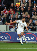 Neil Taylor of Swansea kicks the ball forward during the Barclays Premier League match between Swansea City and Arsenal at the Liberty Stadium, Swansea on October 31st 2015