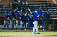 AZL Cubs third base coach Ben Carhart gives signs to a runner on first base during a game against the AZL Giants on September 5, 2017 at Scottsdale Stadium in Scottsdale, Arizona. AZL Cubs defeated the AZL Giants 10-4 to take a 1-0 lead in the Arizona League Championship Series. (Zachary Lucy/Four Seam Images)