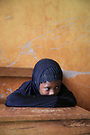 A pupil from the Islamic school in Sunyani, Ghana, listening to the teacher. In Ghana, coranic schools were transformed into islamic schools. Pupils learn the mainstream curriculum and have additional courses in arabic and islam.