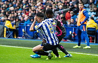 Sheffield Wednesday's Joey Pelupessy holds his face after a challenge from Leeds United's Edward Nketiah (right) <br /> <br /> Photographer Andrew Kearns/CameraSport<br /> <br /> The EFL Sky Bet Championship - Sheffield Wednesday v Leeds United - Saturday 26th October 2019 - Hillsborough - Sheffield<br /> <br /> World Copyright © 2019 CameraSport. All rights reserved. 43 Linden Ave. Countesthorpe. Leicester. England. LE8 5PG - Tel: +44 (0) 116 277 4147 - admin@camerasport.com - www.camerasport.com