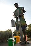 TANZANIA , hand water pump set in Meatu district / TANSANIA,  Junge holt Trinkwasser von einer Wasserpumpe in Meatu