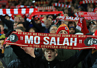 "30th October 2019; Anfield, Liverpool, Merseyside, England; English Football League Cup, Carabao Cup, Liverpool versus Arsenal; a fan on the Kop holds up a Mo Salah scarf as ""You'll Never Walk Alone"" is sung prior to the kick off - Strictly Editorial Use Only. No use with unauthorized audio, video, data, fixture lists, club/league logos or 'live' services. Online in-match use limited to 120 images, no video emulation. No use in betting, games or single club/league/player publications"