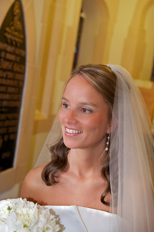 Closeup candid of bride waiting in church vestibule before walking down the aisle.