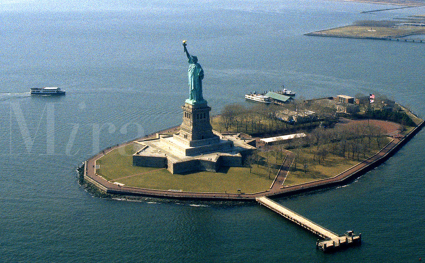 The Statue of Liberty located in New York Harbor- a popular tourist attraction. New York City New York United States New York Harbor, Hudson River, Manhattan.