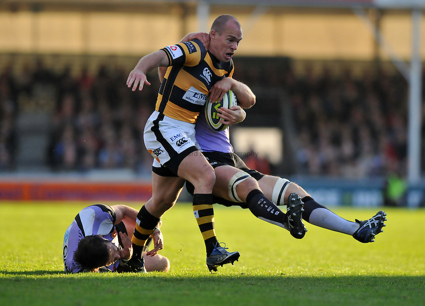 Photo: Tony Oudot/Richard Lane Photography. Exeter Chiefs v London Wasps. LV= Cup. 06/11/2010. .Mark Van Gisbergen goes on a run but is challenged by Chris Whitehead and Andy Miller of Chiefs.