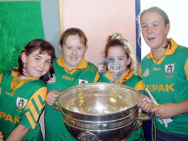 Orla Carroll, Ursula Carroll, Laura Finnegan and Rachael O'Reilly with the Sam Maguire in Castletown National School on Monday..Picture Paul Mohan Newsfile
