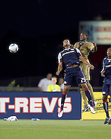 New England Revolution defender Darrius Barnes (25) and Philadelphia Union forward Danny Mwanga (10) battle for head ball. The Philadelphia Union defeated New England Revolution, 2-1, at Gillette Stadium on August 28, 2010.