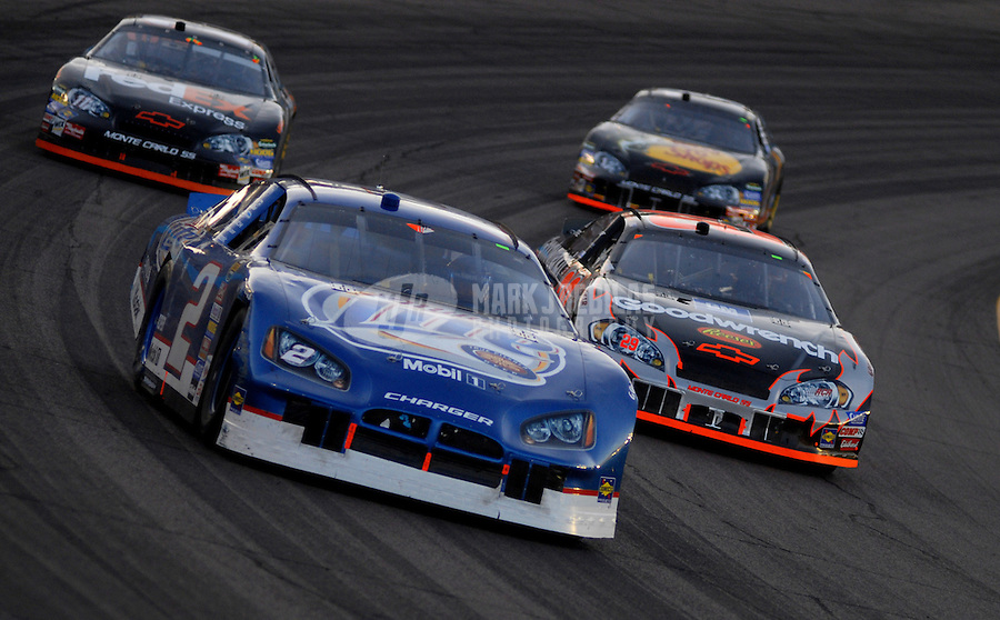 Apr 22, 2006; Phoenix, AZ, USA; Nascar Nextel Cup driver Kyle Busch of the (2) Miller Lite Dodge Charger battles Kevin Harvick in the (29) GM Goodwrench Chevrolet Monte Carlo during the Subway Fresh 500 at Phoenix International Raceway. Mandatory Credit: Mark J. Rebilas-US PRESSWIRE Copyright © 2006 Mark J. Rebilas..