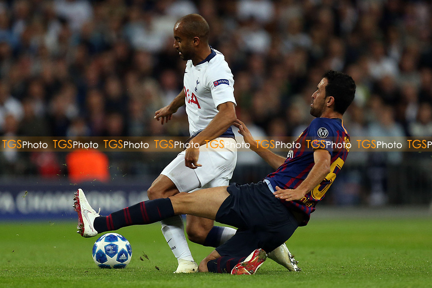 Sergio Busquets of FC Barcelona and Lucas of Tottenham Hotspur during Tottenham Hotspur vs FC Barcelona, UEFA Champions League Football at Wembley Stadium on 3rd October 2018