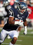 Elijah Mitchell runs for Nevada during the first half of an NCAA college football game against UNLV, in Reno, Nev., on Saturday, Oct. 26, 2013.<br />