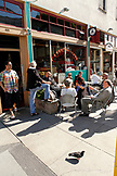 USA, California, San Francisco, locals mingle and drink coffee on the street outside Cafe Trieste, North Beach
