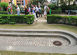 VMI Vincentian Heritage Tour: Members of the Vincentian Mission Institute cohort walk around the outside of the Priory of St Lazare, (107 Rue du Faubourg Saint Denis), Thursday, June 23, 2016, as they toured Vincentian sites in Paris.  The site was home for Vincent de Paul in the latter part of his life and the area also includes the Gare du Nord and the Church of St Vincent de Paul. (DePaul University/Jamie Moncrief)