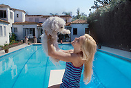 March 1980. Los Angeles, California, USA. French singer Sylvie Vartan with her dog at her house in Los Angeles.