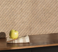 Tweed, a hand-cut tumbled mosaic, shown in Lagos Gold and Driftwood, is part of the Tissé® collection for New Ravenna.