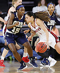 SIOUX FALLS, SD - MARCH 7:  Tia Hemiller #4 of South Dakota makes a move past Faith Ihim #15 of Oral Roberts in 2016 Summit League Tournament play. (Photo by Dick Carlson/Inertia)