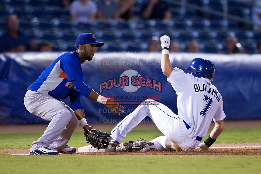 August 19,2010 Alex Valdez (5) tags Charlie Blackmon (7) as he slides into 3rd during the MiLB game between the Midland RockHounds and the Tulsa Drillers at OneOk Field in Tulsa Oklahoma.
