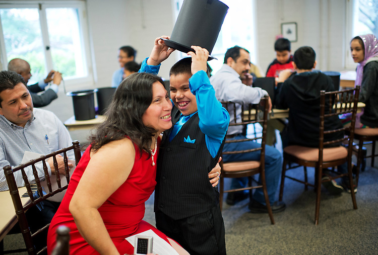 UNITED STATES - APRIL 22: Oscar Umanzor, 9, originally from El Salvador, shares a laugh with his mother Santos Rubio, before a citizenship ceremony at President Lincoln's Cottage in Northwest. Twenty children from fifteen countries, who recently became citizens, participated in a swear-in ceremony. (Photo By Tom Williams/CQ Roll Call)
