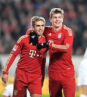 Fussball 1. Bundesliga:  Saison   2011/2012    16. Spieltag VfB Stuttgart - FC Bayern Muenchen  11.12.2011 Philipp Lahm, Toni Kroos (v. li., FC Bayern Muenchen)