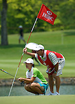 SINGAPORE - MARCH 08:  Angela Park of Brazil and her caddie on the par tree 11th hole during the final round of HSBC Women's Champions at the Tanah Merah Country Club on March 8, 2009 in Singapore. Photo by Victor Fraile / The Power of Sport Images
