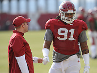 NWA Media/ANDY SHUPE - Arkansas defensive coordinator Robb Smith, left, speaks with defensive tackle Darius Philon during practice Saturday, Dec. 13, 2014, at the university's practice facility in Fayetteville.