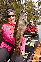 Sport fishing for splake Woman angler with splake