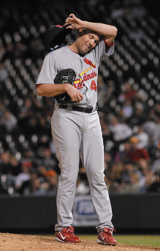 St. Louis Cardinals starting pitcher Braden Looper wipes his brow after 8 1/3 innings of work against the Colorado Rockies. The Cardinals defeated the Rockies 6-5 at Coors Field in Denver, Colorado on May 6, 2008.
