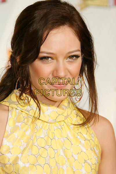HILARY DUFF.20th Annual Nickelodeon Kids' Choice Awards held at UCLA's Pauley Pavilion, Westwood, California, USA,.31 March 2007..portrait headshot gold hoop earrings yellow dress.CAP/ADM/RE.©Russ Elliot/AdMedia/Capital Pictures.