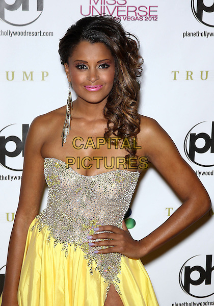 Claudia Jordan.Miss USA Olivia Culpo named Miss Universe 2012 at Planet Hollywood Resort and Casino, Red Carpet, Las Vegas, NV., USA..December 19th, 2012.half length dress hands on hips silver strapless yellow cleavage embellished jewel encrusted pink lipstick earring.CAP/ADM/MJT.© MJT/AdMedia/Capital Pictures.