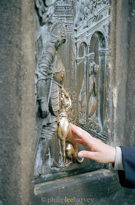 An engraving believed to give good luck on the Statue of St John of Nepomuk, Charles Bridge, Prague, Czech Republic