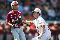 Oklahoma Sooners shortstop Jack Mayfield #8 is tagged out by Texas Longhorns pitcher Dillon Peters #32 after laying down a sacrifice bunt in the NCAA baseball game on April 6, 2013 at UFCU DischFalk Field in Austin, Texas. The Longhorns defeated the rival Sooners 1-0. (Andrew Woolley/Four Seam Images).