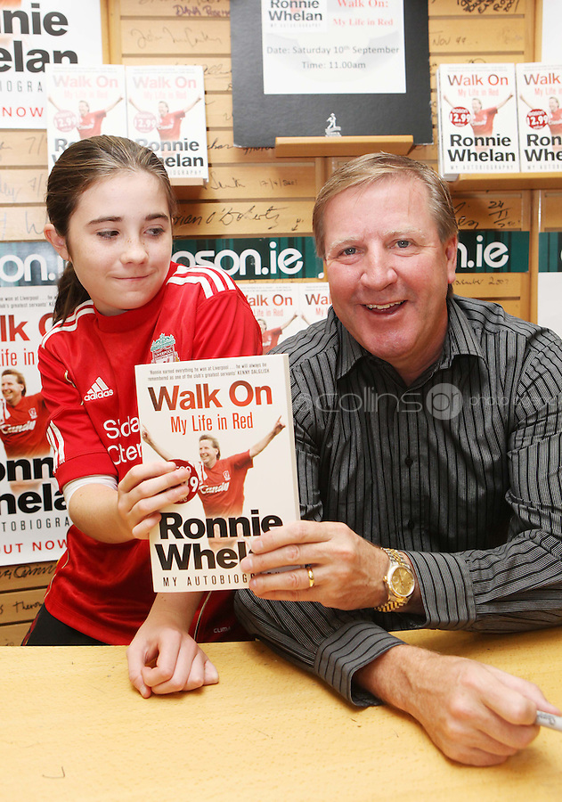 ***NO FEE PIC ***.10/09/2011.Eason Ireland's leading retailer of books , stationery, magazines & lots more hosted a book signing by former Liverpool & Irish international soccer player Ronnie Whelan..Pictured at Eason O' Connell street, Dublin is Ronnie Whelan &  Eabha Byrne (12) from raheny.signing copies of his new autobiography WALK ON for fans..Follow Eason on twitter- @easons..Photo: Collins