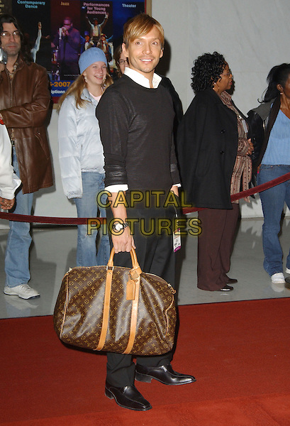 KEN PAVES.Arrivals - 29th Annual Kennedy Center Honors, .held at the John F. Kennedy Center for the Performing Arts, Washington, D.C. USA, 03 December 2006..full length louis vuitton bag.CAP/ADM/GS.©George Shepherd/AdMedia/Capital Pictures