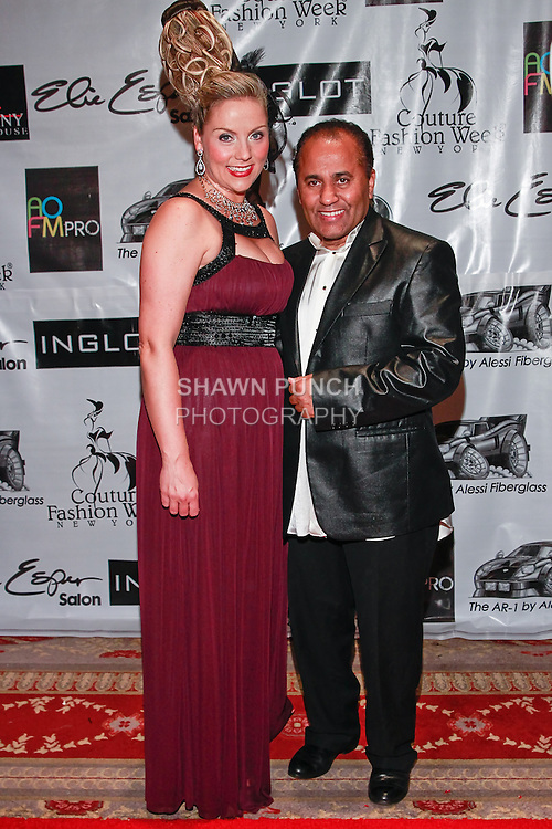Soprano singer Christine Reber poses on red carpet with fashion producer Andres Aquino, during Couture Fashion Week Spring 2012, at the Waldorf Astoria-Hotel in New York City.
