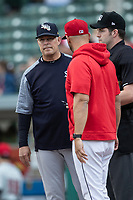 Hitting coach Phil Plantier (33) of the Scranton/Wilkes-Barre RailRiders delivers the lineup to the umpire before the game at Victory Field on May 14, 2019 in Indianapolis, Indiana. The Indians defeated the RailRiders 4-2. (Andrew Woolley/Four Seam Images)